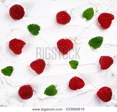 Top View Of White Whipped Cream Texture With Raspberry And Mint Leaves.
