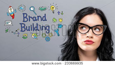 Brand Building With Young Businesswoman In A Thoughtful Face