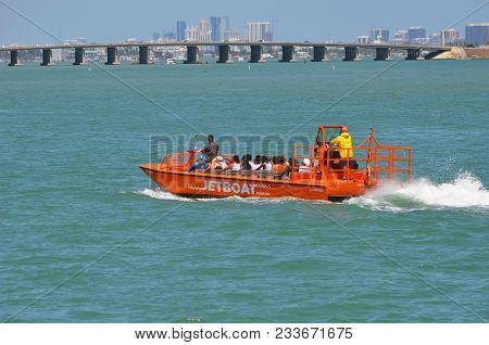 Tourist Enjoying A Jet Boat Tour Of Miami And Miami Beach On 25 March 2018.  The Jet Boat Blends Sig