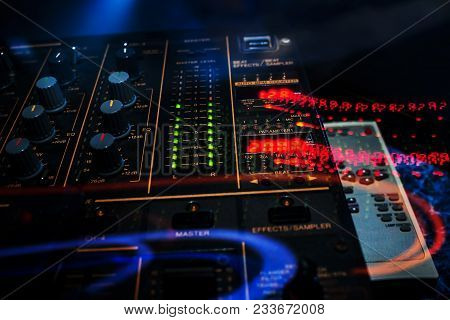 Control Buttons And Mixing Music On Professional Equipment For Mixing And Dj