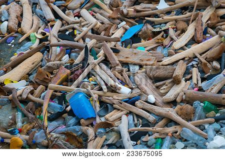 Ocean Pollution - Trash And Waste On  Polluted Beach Closeup  -