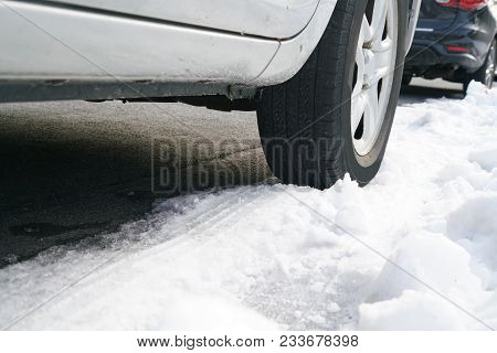 Low Angle View On Vehicle Tire On Snow In The Street