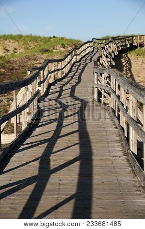 Old Weathered Wooden Walkway Leads To Beach On Plum Island In Massachusetts.