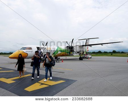 Thai People And Traveler Passengers Walking Go To Inside Building After Airplane Twin Propeller Land