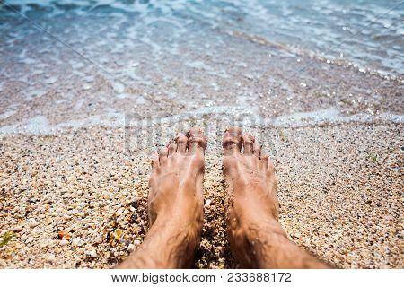 Feet In The Sea Water.