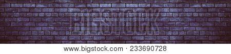 Dark Violet Brick Wall. Wide Brickwork Texture. Gloomy Grunge Background