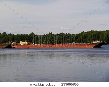 Old Barge On River. Barge Sailing On The River Dnieper. Barge With Cargo Is Floating On River In Sum