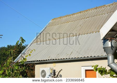 Repair Asbestos Roof Tiles With New Sheets. Roofing Construction.