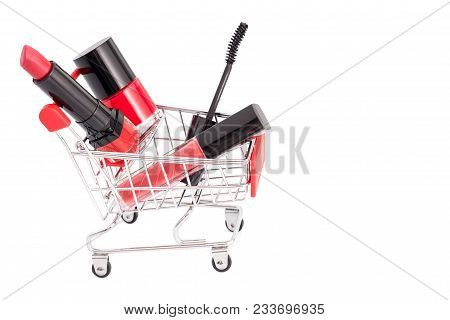 Makeup In Pushcart Isolated On White Background. Red Lipstick, Mascara, Pink Lip Gloss, Powder, Nail