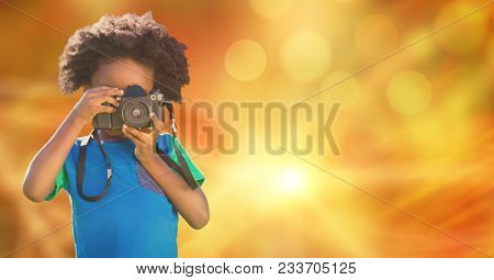 Digital composite of Child photographing over blur background