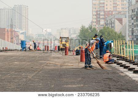 Tyumen, Russia - July 31, 2013: Jsc Mostostroy-11. Bridge Construction On Melnikayte Street Through