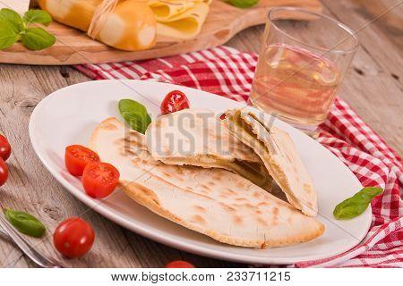 Cascione Italian Flatbread With Cheess On Wooden Table.