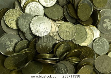 Plant Growing In Savings Coins On Wooden Background- Investment And Interest Concept. Money Growing