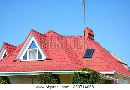 Close Up On Red Metal Roof With Mansard, Skylight Window, Roof Guttering Pipeline System Problem Are