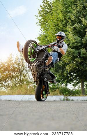 Ivano-frankivsk, Ukraine - 28 August 2015 : In Need Of Extreme , Young Biker Is Practising In Doing