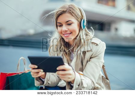 Happy Woman Watching Media Content In A Digital Tablet