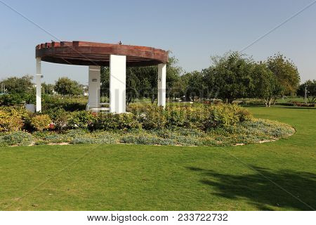 AL BIDDA PARK, DOHA, QATAR - March 28, 2018: A view across the newly opened park in the centre of Qatar's capital, with a covered picnic area and flowerbeds.