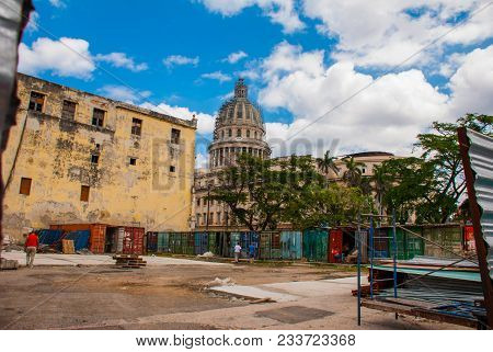 Capitolio Nacional, El Capitolio On Blue Sky Background With Clouds. Dirty Metal Multi-colored Garag
