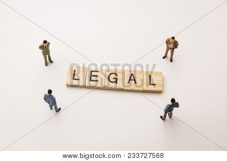 Miniature Figures Businessman : Meeting On Legal Letters By Wooden Block Word On White Paper Backgro