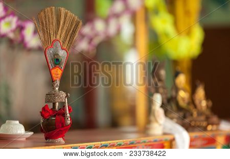 The Ritual Vessel Filled With Saffron-yellow Water With Ornament In The Form Of A Peacock Feather, I