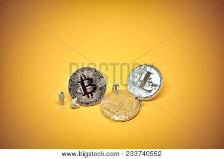 Team Of Criminal Specialists Inspecting Bitcoin And Litecoin Coins