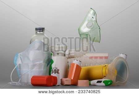 Modern Electronic Mesh-nebulizer Small Portable Inhaler, Vials Of Liquid For Inhalation, On Gray Bac