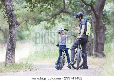 Family Of Two, Young Father And Cheerful Son, Enjoying Bike Riding, Kid Giving High Five To His Dad,