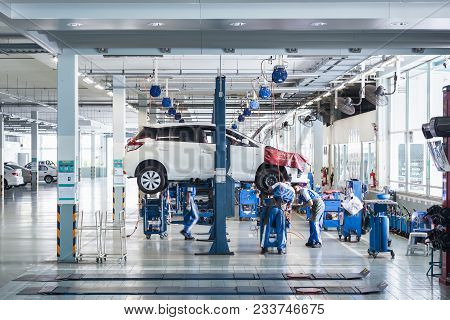 Phuket, Thailand - March 7 : Car Technician Repairing Car In Workshop Service Station In Phuket On M