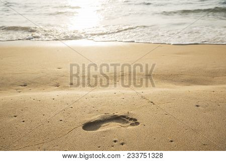 A Foot Print On The Beach In The Evening Before Sunset