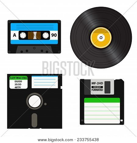 Set Of Media Of Different Generations - Vinyl Record, Cassette Tape, A 3.5-inch Floppy Disk On A 5.2