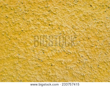 Сoncrete Of Yellow Plastered Wall. Yellow Plastered Wall Texture Grunge Background. Beautiful Decora