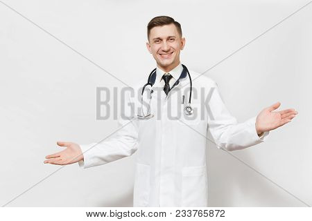 Smiling Happy Young Doctor Man Isolated On White Background. Male Doctor In Medical Gown And Stethos