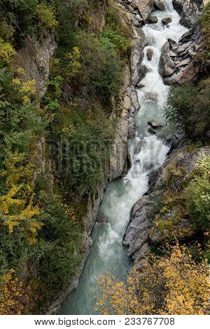 Mountain River And Trees Landscape Natural Environment. Hiking In The Alps. Colored Hills, Big Mount