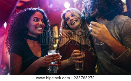 Happy Young Women Partying Friends At Bar. Group Of Friends Having A Good Time At Nightclub.