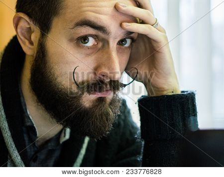 Modern, Expressive Bearded Office Clerk With Mustages Working With Notebook Laptop At Office