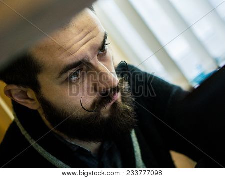 Modern, Expressive Bearded Office Clerk With Adorable Mustages Bored To Work In Office