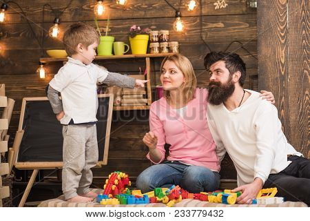 Kid With Parents Play With Plastic Blocks, Build Construction. Parents Hugs, Watching Son Playing, E