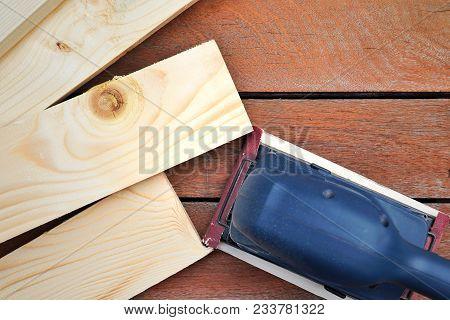 Electric Sander,power Finishing Sander On Pine Board.electric Orbital Sandpaper Closeup, Planer Tool