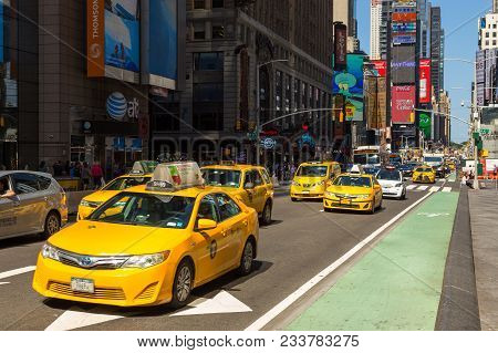 New York, Nyc, Usa-august 30, 2017: Yellow Cabs At Times Square , Midtown Manhattan. Big Advertiseme