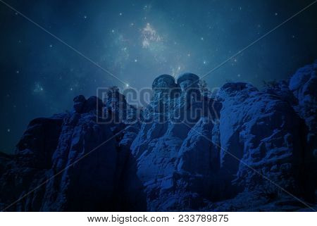 A Night Scene Of A Premade Background With Stars, Nebulas And Cliffs.