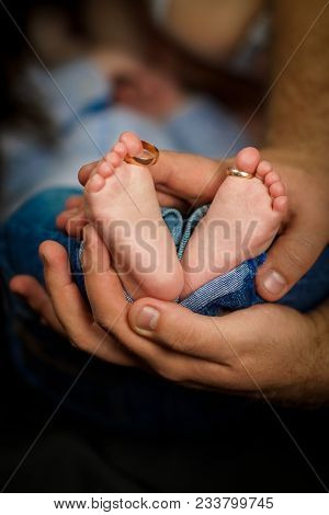 Baby Feet. Happy Family Concept. Beautiful Conceptual Image Of Maternity