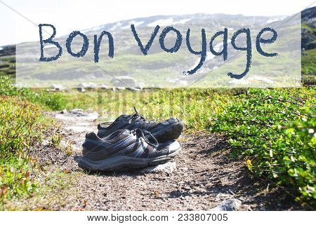 French Text Bon Voyage Means Good Trip. Trekking Shoes On Hiking Path In Norway. Mountains In The Ba