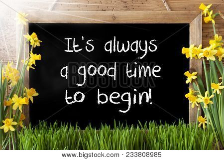 Blackboard With English Quote It Is Always A Good Time To Begin. Sunny Spring Flowers Nacissus Or Da