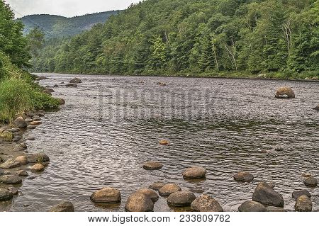 Hudson River Running Through The Adirondack Mountains In New York