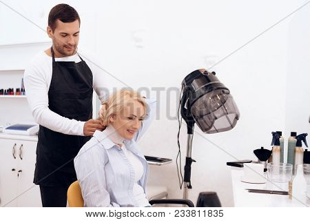 Mature Pretty Woman Is Doing Hairdo In Beauty Salon. Female Stylish Haircut. Young Stylist Thinks Wh