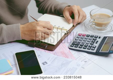 Stressed Asian Man Working Through Paperwork, Calculating Expenses, Trying To Save Some Money, Manag