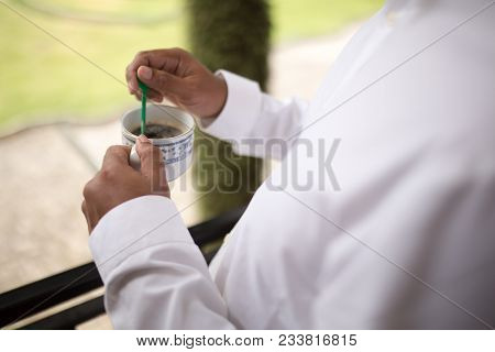 Man Or Businessman Hand Holding Coffee Cup For Advertising Coffee Or Breakfast And Coffee Theme