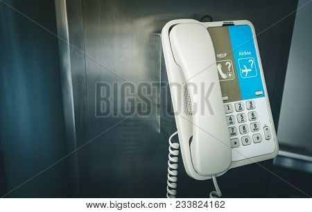 Close Up Of Internal Phone Or Infomation Telephone Hanging On A Pole In The International Airport Fo