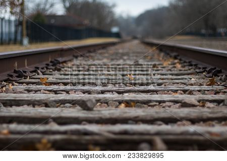 Close Up Low Angel Of Railroad Tracks, Very Shallow Depth Of Field Leaving The Track To Fade Off Int