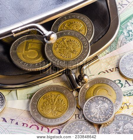 Polish Zloty (pln) Paper Currency Banknotes And Coins In Black Wallet In Vintage Style. Concept Econ